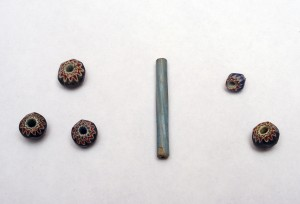 Glass trade beads found at the Luna settlement, including five seven-layer faceted chevron beads, and one tubular Nueva Cadiz Twisted bead.