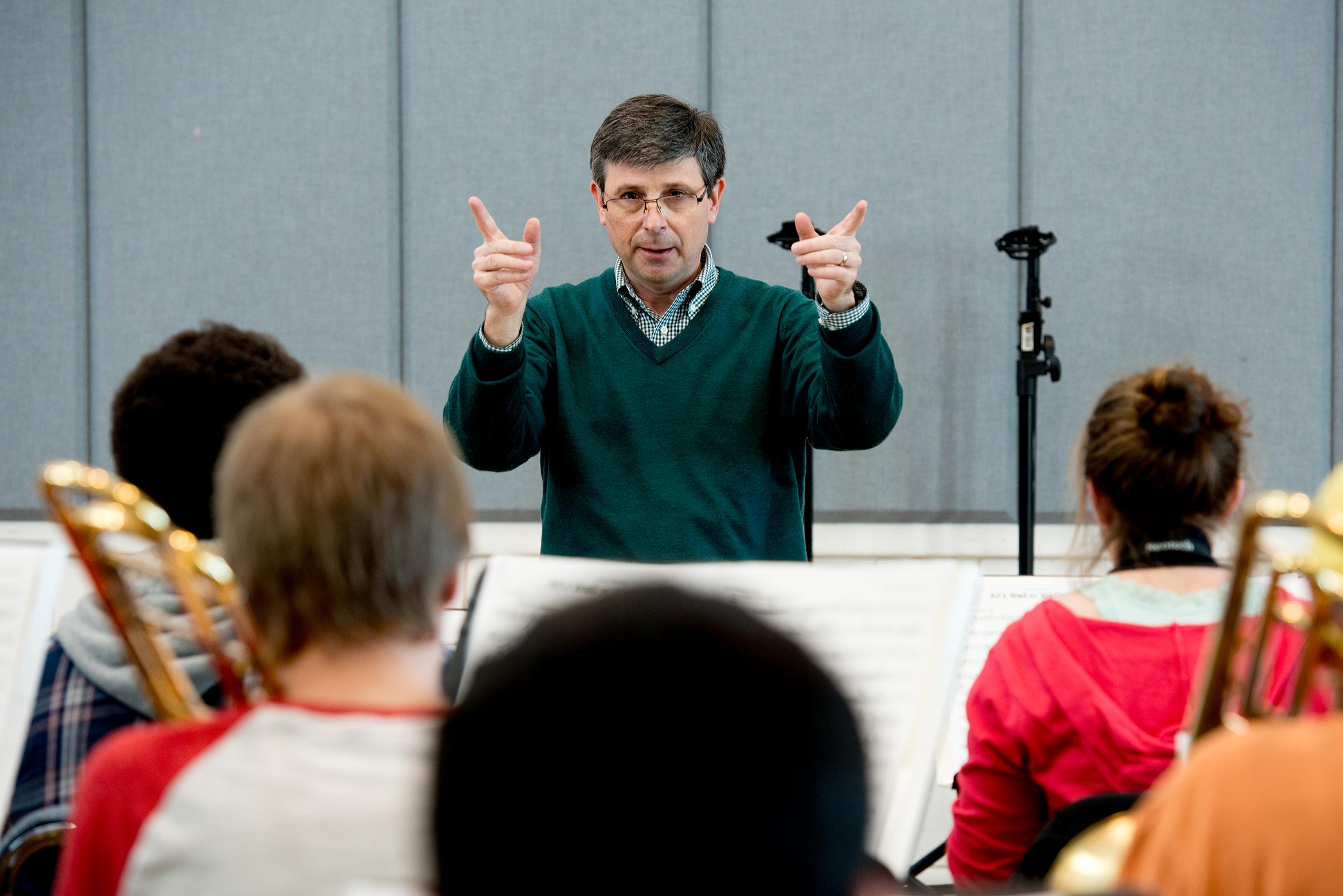 Dr. Joseph Spaniola leads the jazz ensemble rehearsal at the University of West Florida.