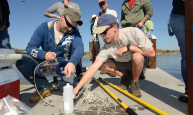 Adam Roberts a UWF senior and Greg Leenig a UWF junior learn to take a water sample using a vandorn during the Bream Fishermen Association's Environmental Water Sampling Academy at the 17th Ave. boat ramp.
