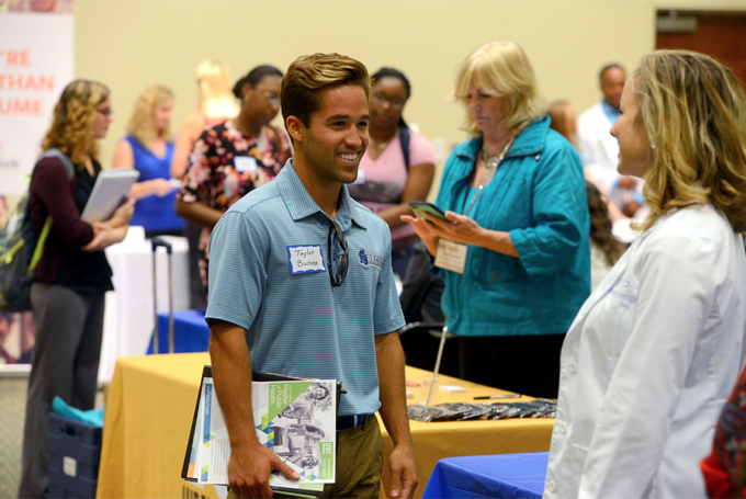 Students meet with local business partners at the Career Development and Community Engagement career fair