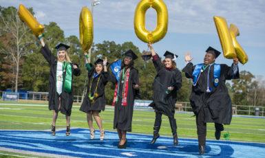 Fall 2018 graduates celebrating UWF's 100,000th degree