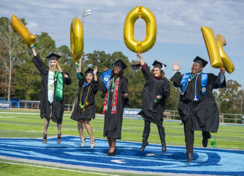 Fall 2018 graduates celebrating UWF's 100,000th degree