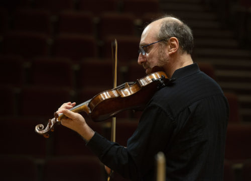 """Dr. Leonid Yanovskiy, director of the UWF String Program, conducts the """"Runge Strings"""" Orchestra as they rehearse for their upcoming performance at the University of West Florida."""