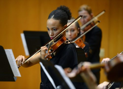 Members of the The Runge Strings Ensemble rehearse in the Music Hall at the University of West Florida.