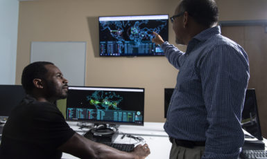 Dr. Guillermo Francia III, faculty scholar of the UWF Center for Cybersecurity, instructing a UWF student in the Cybersecurity Battle Lab in the Science and Engineering Building, Building 4.