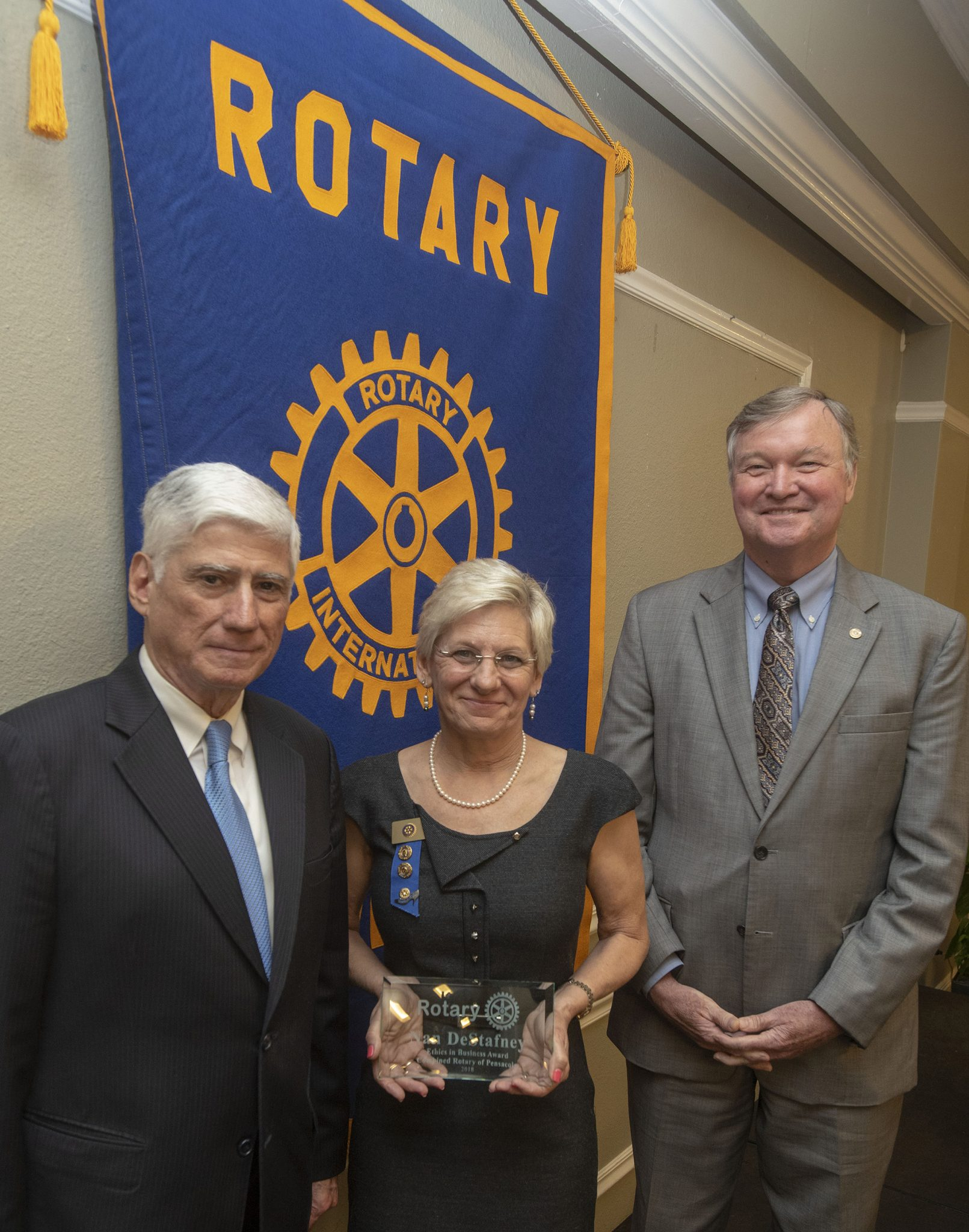 Nan DeStafney, 2018 winner of the Rotary Ethics in Business Award, with Dr. Ed Ranelli and Ted Kirchharr.