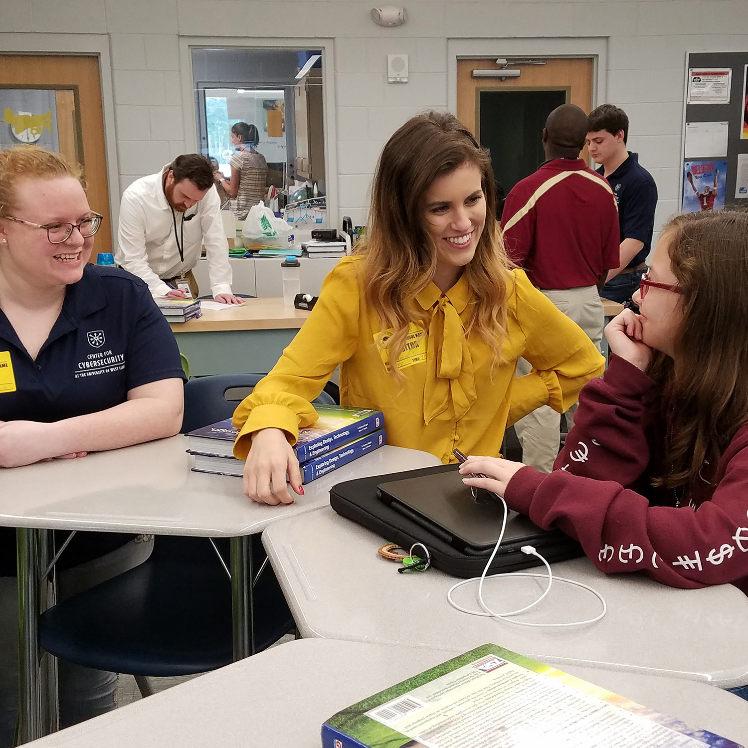 Cybersecurity ambassadors Megan Mortonand Caroline Krouse answer cybersecurity questions from a Beulah Middle School student.