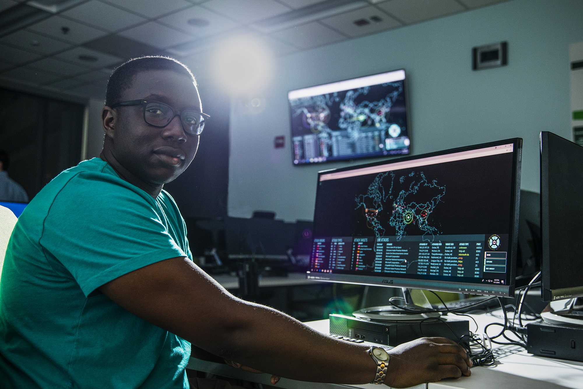 UWF student Basil Kuloba in the Cybersecurity Battle Lab in the Science and Engineering Building, Building 4.