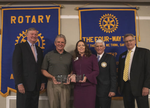 Olevia McNally and David Apple, recipients of the 2019 Ethics in Business Awards, posing for a photo with rotary leaders during the seventeenth annual event held on May 6 at New World Landing in Downtown Pensacola.