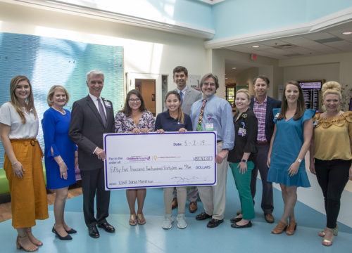 UWF Dance Marathon Executive Board members present check to Pensacola's Studer Family Children's Hospital at Sacred Heart