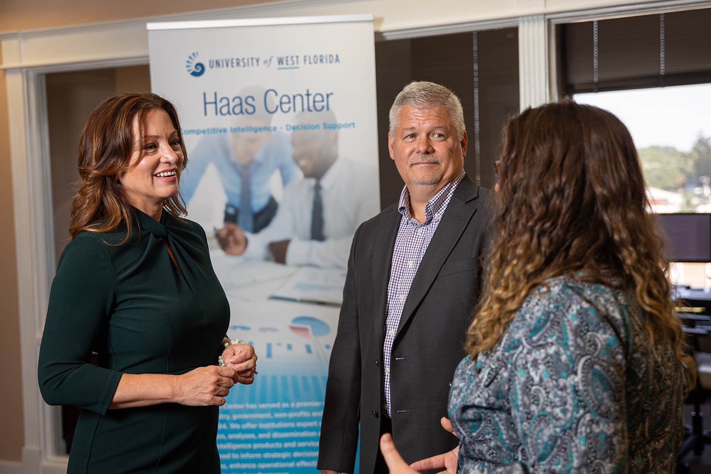 Nicole Gislason, interim assistant vice president of the UWF Haas Center with team members