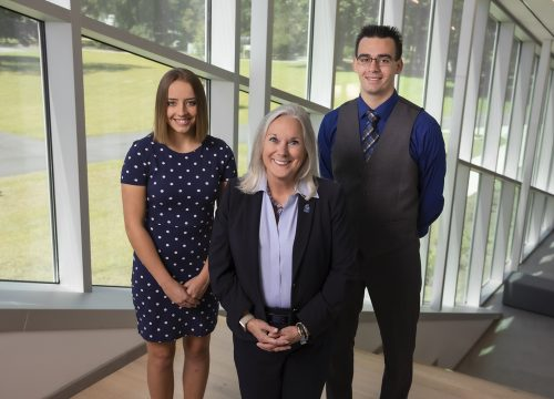 UWF President Martha D. Saunders with 2019 UWF National Merit Finalists Adeline Watson and Shane Durepo