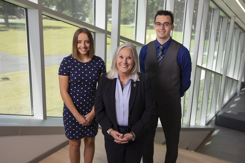 UWF President Martha D. Saunders with 2019 UWF National Merit Finalists Adeline Watson and Shane Durepo