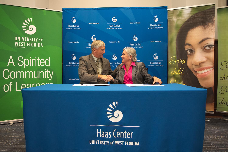 UWF President Martha D. Saunders with Santa Rosa County Superintendent of Schools Tim Wyrosdick