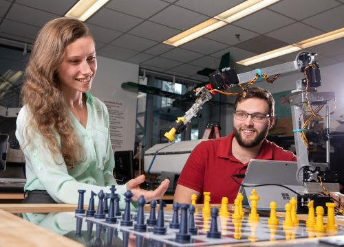 UWF engineering students working on a mechatronics project in the Hal Marcus College of Science and Engineering