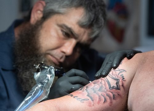 "Shane ""Big Jolly"" gives a tattoo to Brandon Gallups at Gulf Coast Tattoos"
