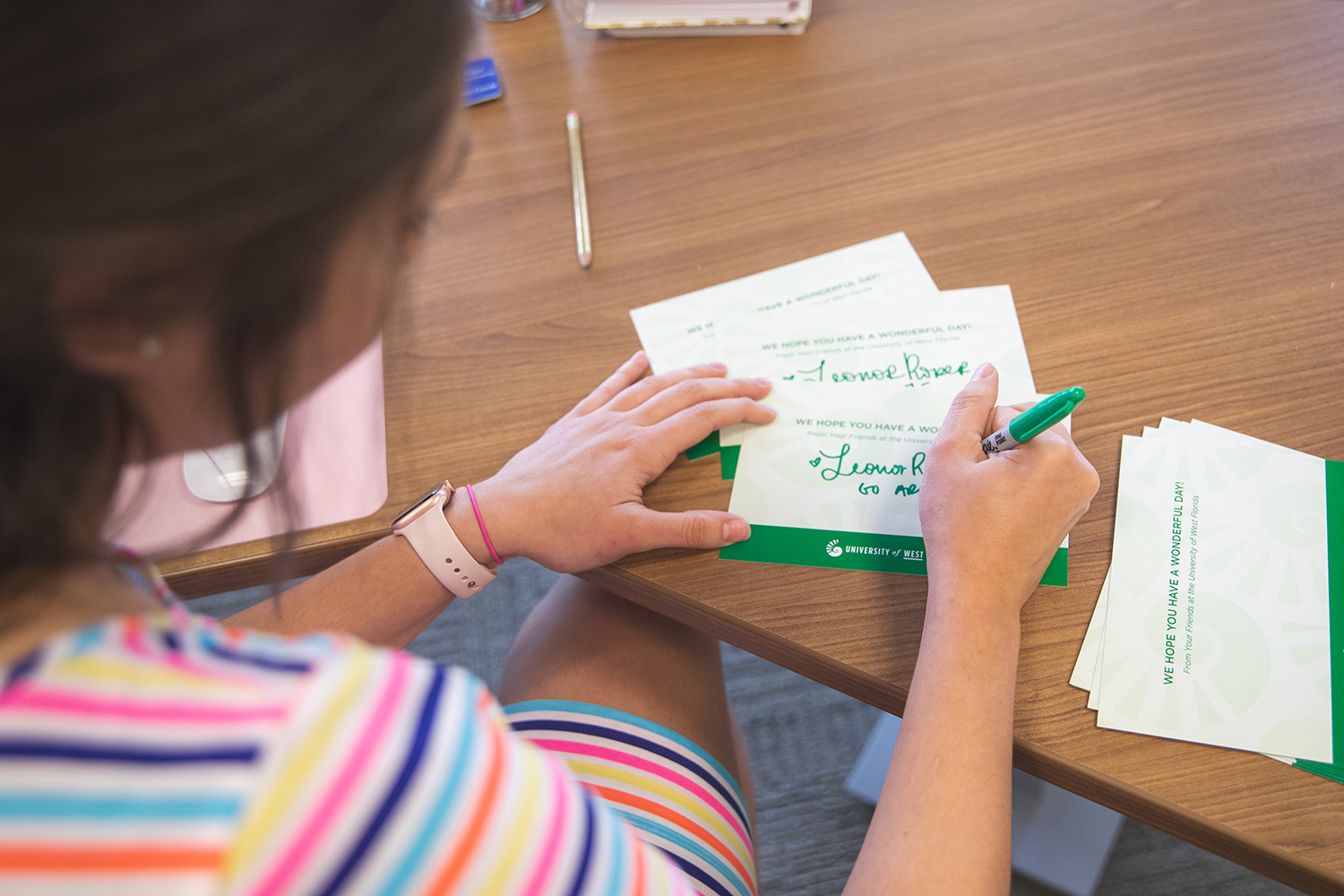 UWF faculty sign greeting cards for nursing home residents on March 27, 2020 in Crosby Hall, Building 10.