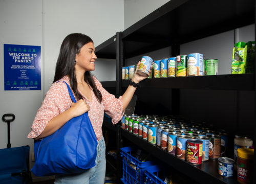 UWF student in the Argo Pantry, picking up nonperishables.