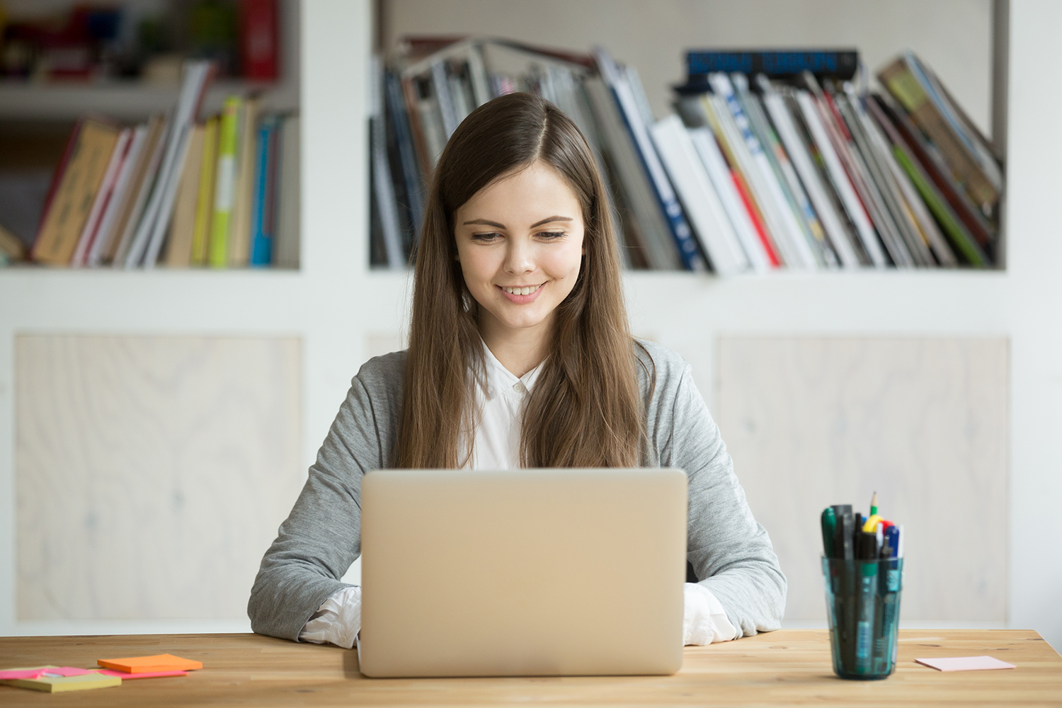 Smiling girl using laptop, student studying at home, digital education, teenager typing on computer browsing web, blogger influencer chatting online in social networks, woman working on pc in office