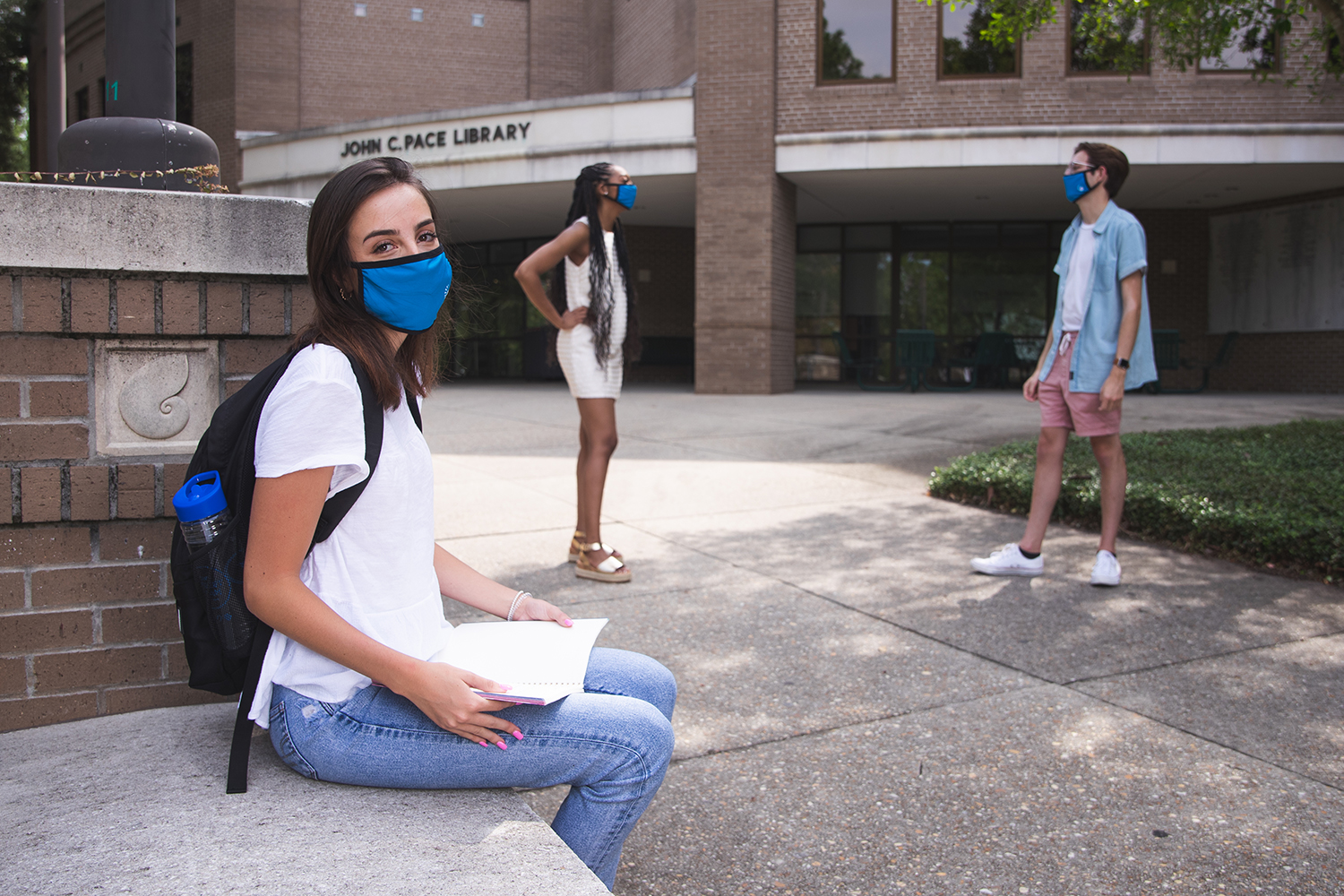 UWF students venture about campus while wearing face protection on Aug. 19, 2020.
