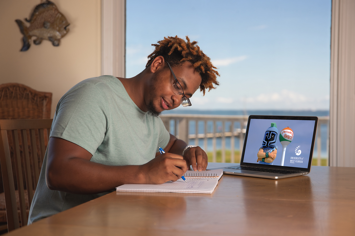 A UWF student takes advantage of online education by taking classes online at a beach house on Pensacola Beach on June 5, 2020.
