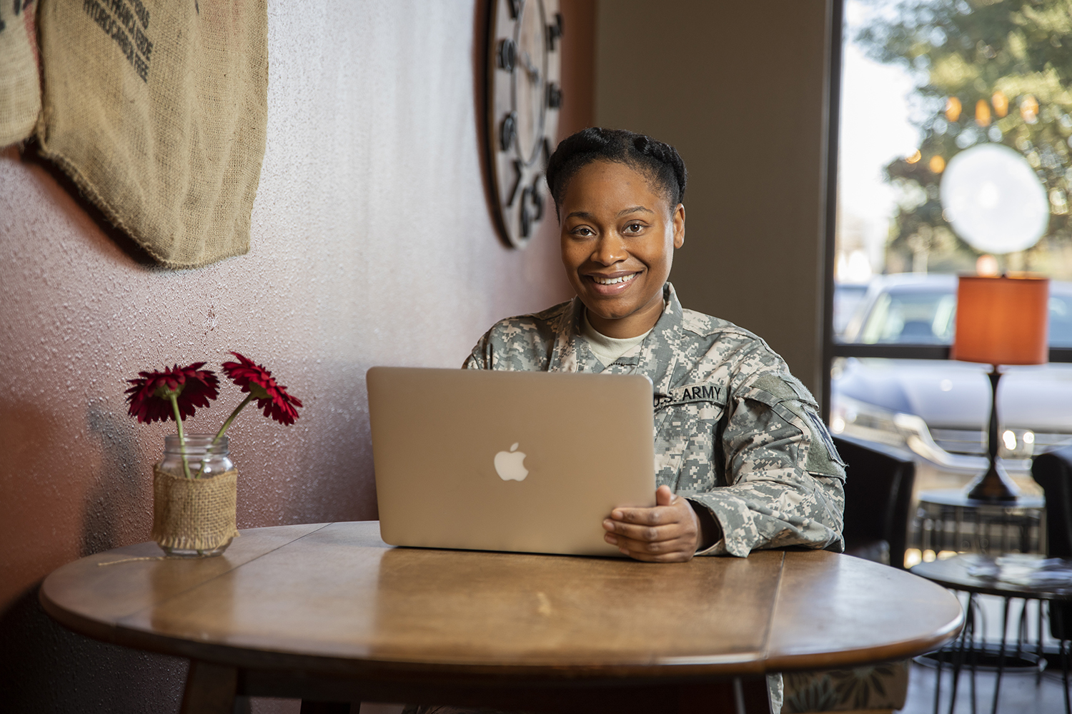 A UWF military student studying and completing coursework at the Coffee Break Cafe coffee shop in Pace, Florida on Monday, Jan. 28, 2019. Thanks to UWF's online course offerings, students can take courses and earn a university degree no matter where they may be.