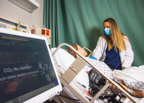 UWF nursing student in the Nursing Skills and Simulation Learning Center