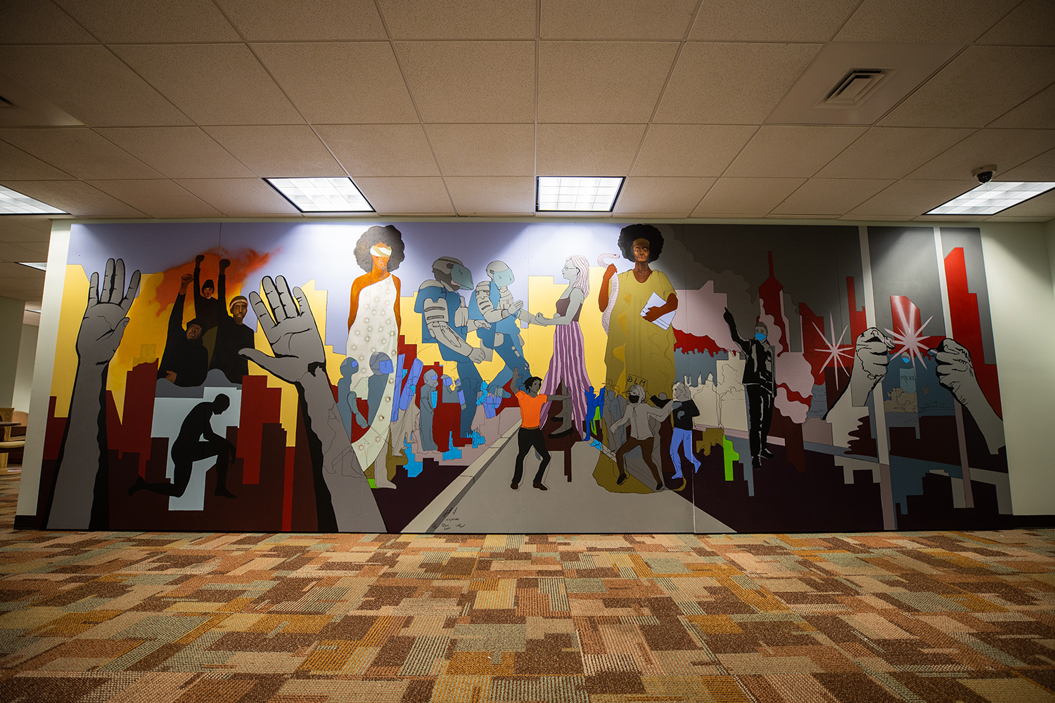 Process photos and final images of UWF resident artist Marzia Ransom's Black Lives Matter mural.